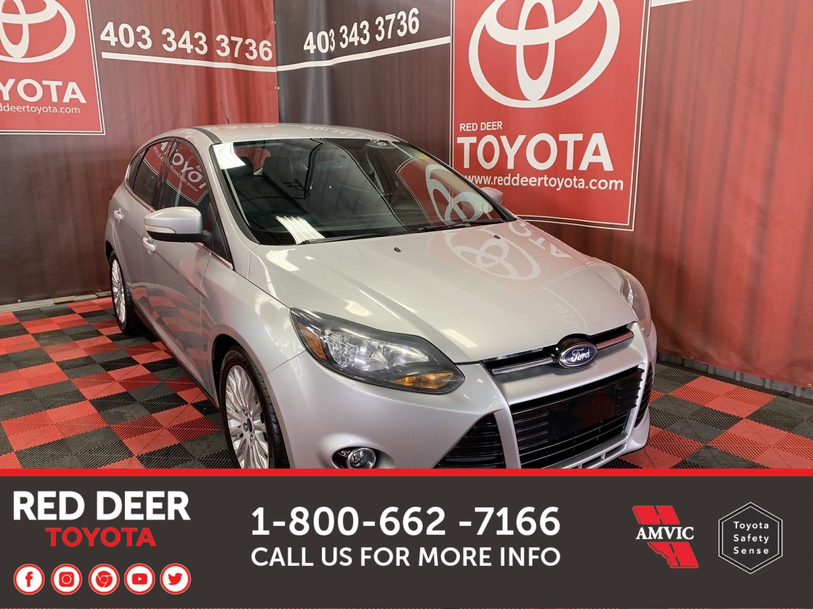 Pre-Owned 2012 Ford Focus Titanium FWD Hatchback
